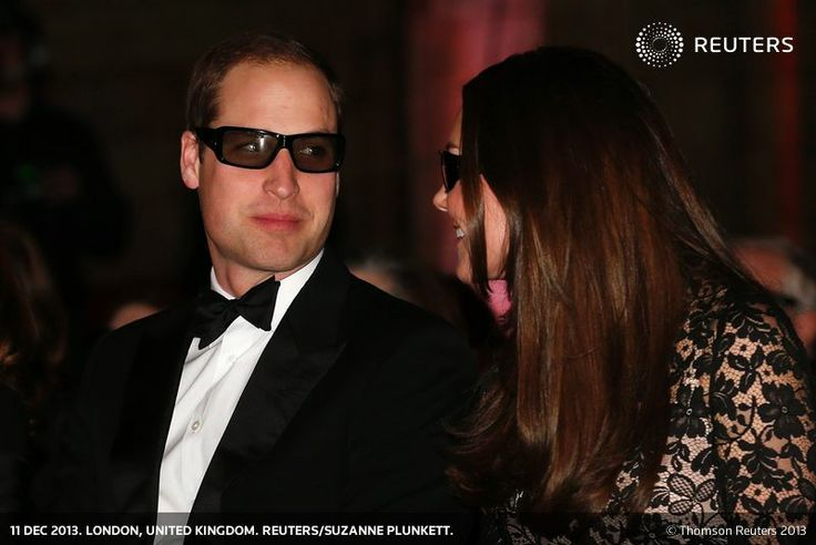 """Britain's Prince William and his wife Catherine, the Duchess of Cambridge, wear 3D glasses before a screening of """"David Attenborough's Natural History Museum Alive 3D"""" at the Natural History Museum in London December 11, 2013. REUTERS/Suzanne Plunkett"""