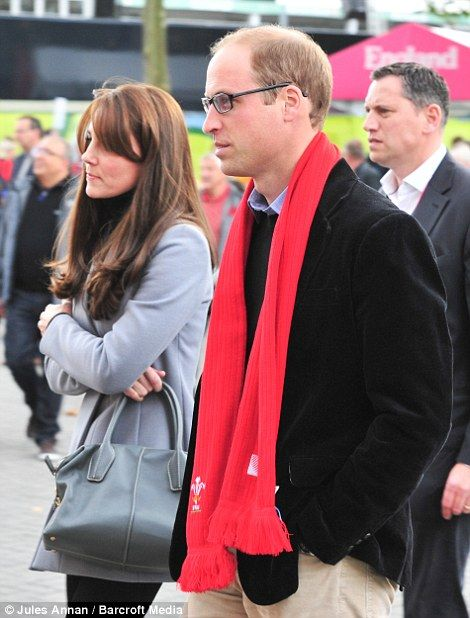 The couple arrived at the game this afternoon after visiting Harrow College in north west London to speak with volunteers at the charity Mind