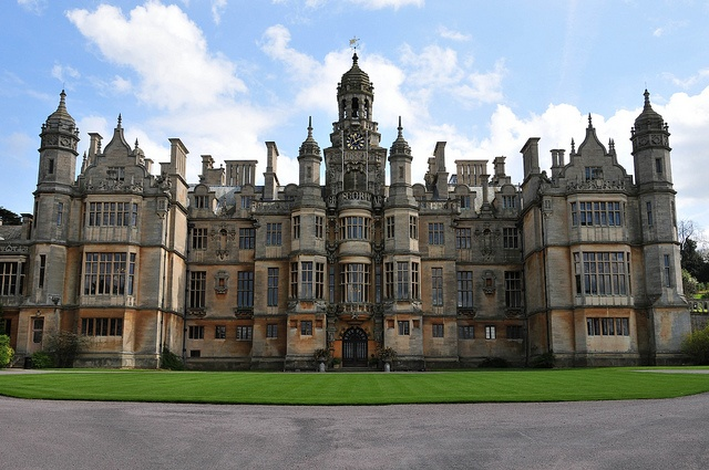 Harlaxton Manor, built in 1837, is a manor house located in Harlaxton, Lincolnshire, England. Its architecture, which combines elements of Jacobean and Elizabethan styles with symmetrical Baroque massing, renders the mansion unique among surviving Jacobethan manors.