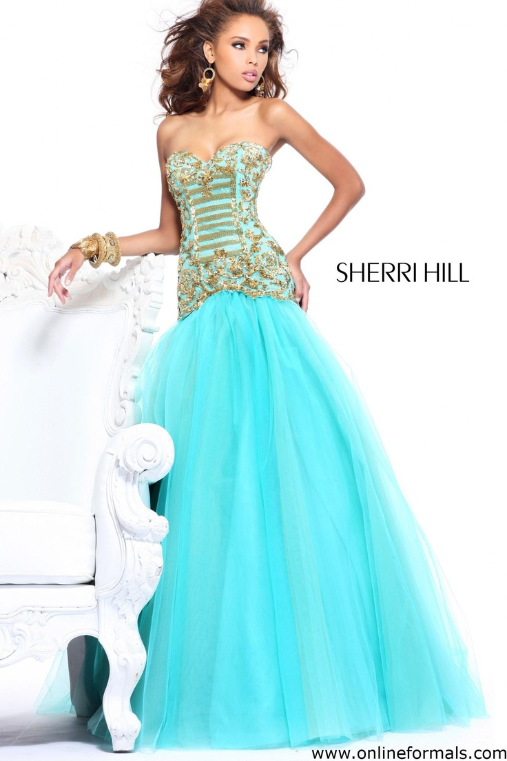 Feel fantastic in this splendid evening gown by Sherri Hill. The strapless sweetheart bodice glitters with fashionable sequined lace embellishments and sparkling beadwork for a figure-flattering look. Fitted to the low hip, this magical dress has a full-length, ball gown skirt for a playful and chic style. Color: Auqa & Gold Fabric: 100% polyester $95.00