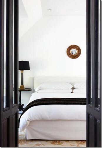 A beautiful white room with touches of black and gold