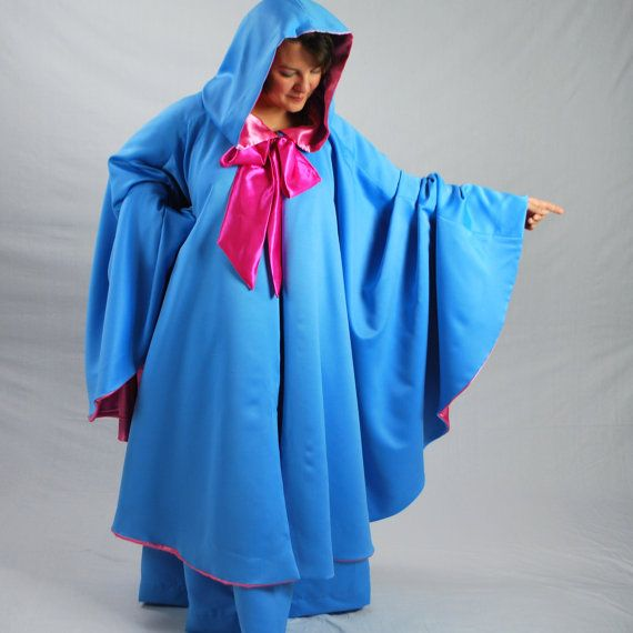 Bippity! Boppity! OOooooooo! An updated interpretation of the movie classic thats easy to wear. This set includes a cape and full length skirt in twilight blue matte satin . The cape is fully lined in pink satin with the signature magenta bow and pointed hood. *3/4 circle cape, 40 from neck to hem *Neck-17 *Closes with a reinforced velcro tab, under the bow. *Fits most women, including plus sizes. *Select skirt size at checkout *Dryclean only