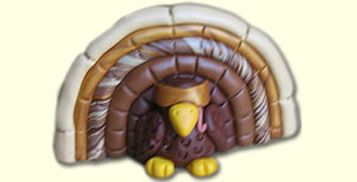 Make this clever little turkey for the holidays; he's great as a pin or a place card holder.
