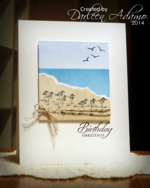 "By Darleen Adamo (darleenstamps - at Splitcoaststampers). On white cardstock panel, mask water and sponge sky; mask sky and sponge water. Tear piece of tan white-core cardstock; Stamp sandpipers from ""Wetlands"" (Stampin' Up) on this piece in black. Add tan piece to sponged panel. Stamp or draw birds in sky. Add linen thread. Pop up on white card base."