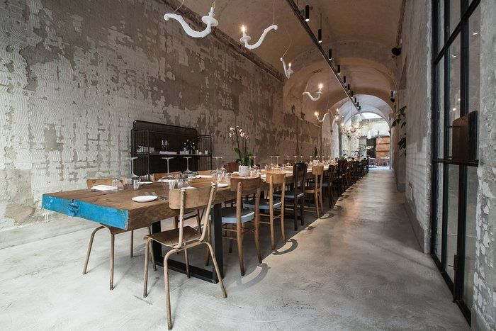 La Menagere (Florence, Italy), q-bic. exposed concrete walls, long shared restaurant table