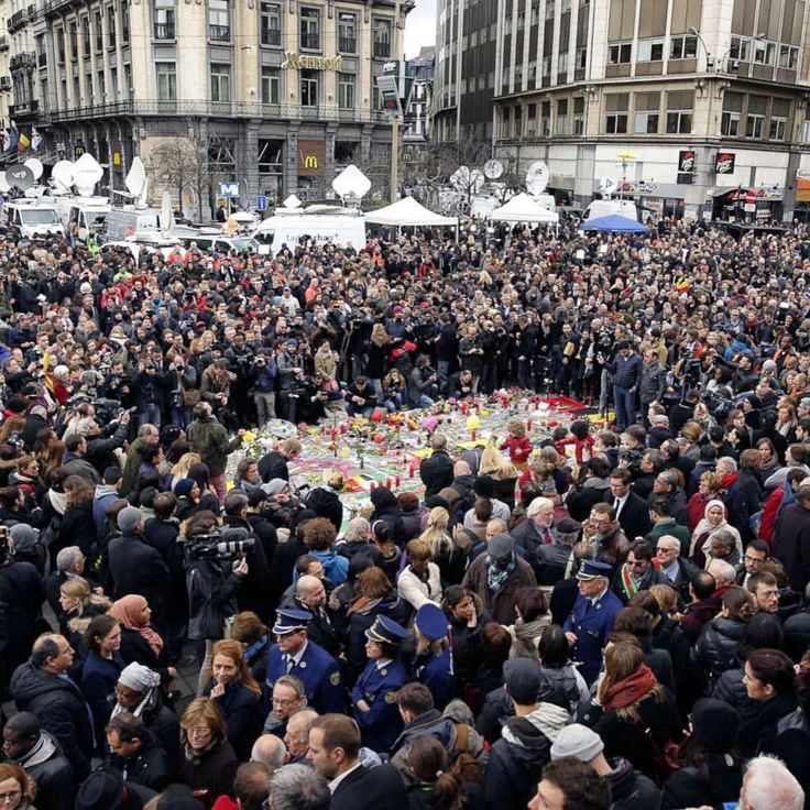 People hold a moment of silence around a #memorial at Place deal Bourse after #Brussels attacks. #Belgium #news (Kenzo Tribouillard/AFP/Getty Images)