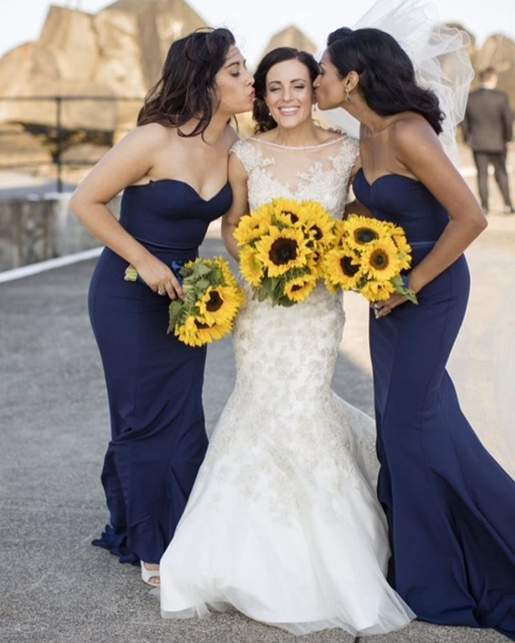 Beautiful combination of navy blue bridesmaid dresses with sunflower bouquets. Love it!