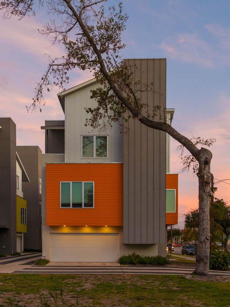 This Fun Modern Facade Is Made Of Orange And Tan Corrugated Sheet Metal The