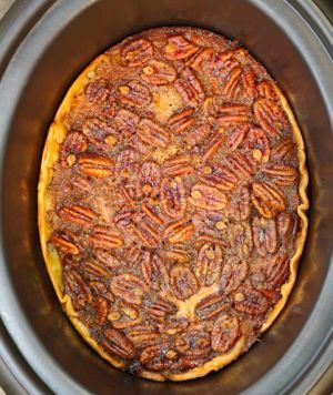 Crock Pot Pecan Pie -                            1 uncooked piecrust   3 eggs   1 cup sugar   2/3 cup dark Karo syrup   1 cup pecans, broken up   1/2 cup margarine, melted   1 teaspoon vanilla