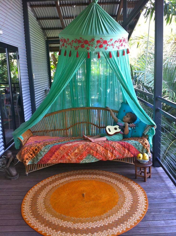 You - the occasionally gifted sewer - could recreate this with a hula hoop, inexpensive cotton gauze (dye it any colour!) some trim embellishments, et voila... or just buy it. mosquito net www.dholamaru.com. via Jazmen P.