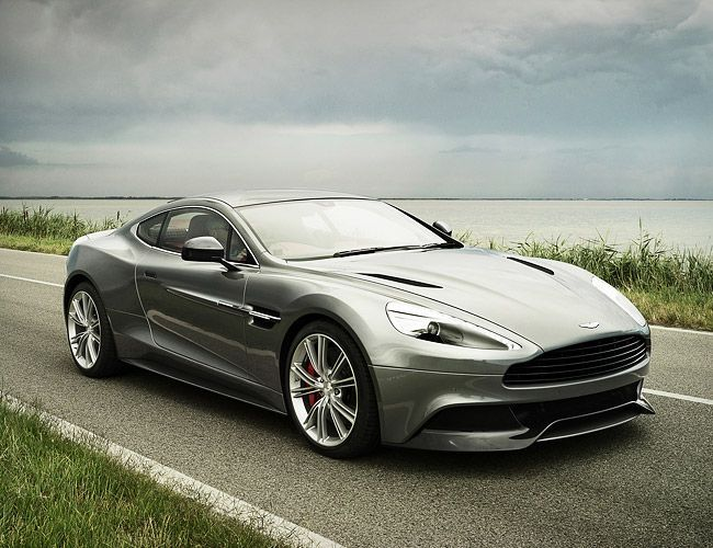 Aston Martin 2013 Vanquish name returns with LED illuminated rear light blades and longer side strakes, a new 6.0 liter V12 engine mated to a Touchtronic 2 6-speed automatic transmission that will reach 60 in 4