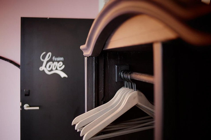 a vintage wardrobe without doors, just stained black / by Tinquer interiors in fusion hotel prague