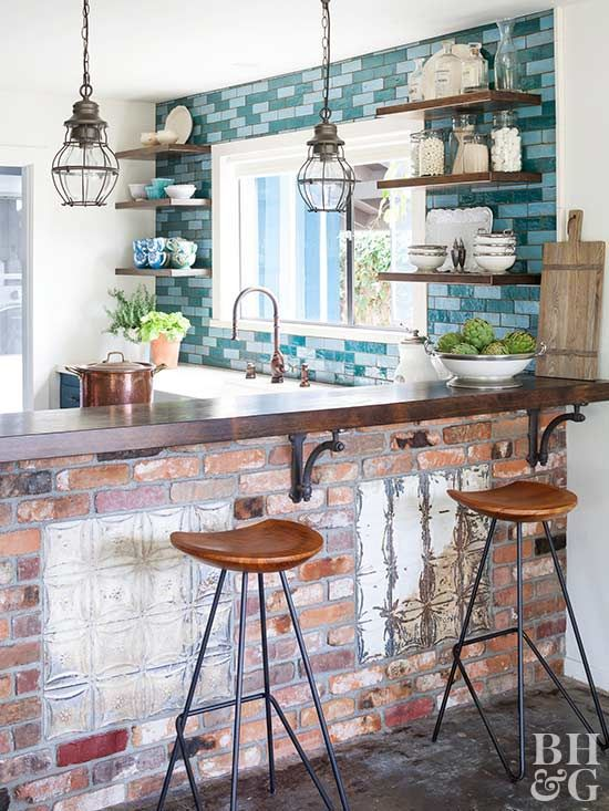 This blue tile backsplash is everything! Love the bold color behind open shelves.