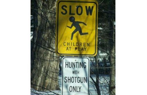 Well, pretty sure that neither Virginia nor West Virginia allows hunting children with shotguns...yet this is a STRANGE sign...