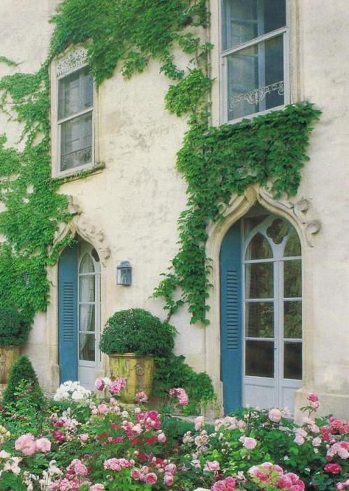Beautiful Stone Home Exterior Covered In Green Vines A D