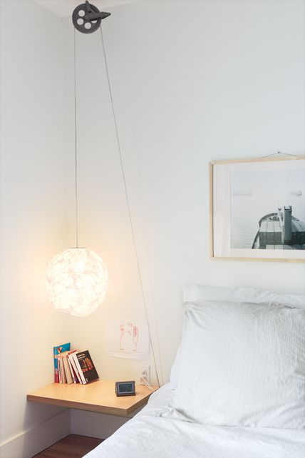 "Separate Boîte Equal - ""For a simple, low-cost bedside reading light with a dash of industrial style, Bernier ran a standard-issue cord set through a vintage clothesline pulley, which he picked up at a flea market, on Thibault's side of the bed. """