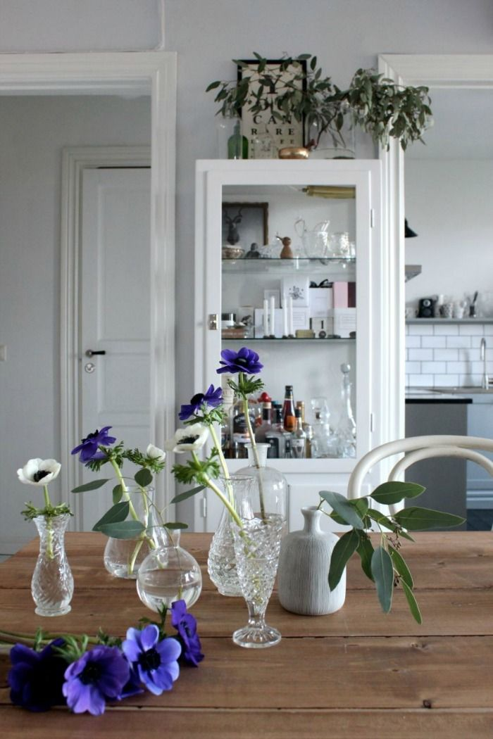 clear cut glass and single flowers white cabinets of any kind are good bc white looks good on everything