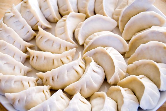 **Chinese dumplings and potstickers recipe.  Used this recipe as a base for making my own potstickers, which turned out so delicious!  Also, followed this recipe for instructions on how to pan-fry them.  Just like street food in China - Yum!
