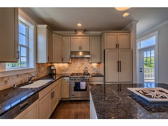 Northwest style kitchen. Beach and nautical touches with beautiful granite counters, making elegant living easy.