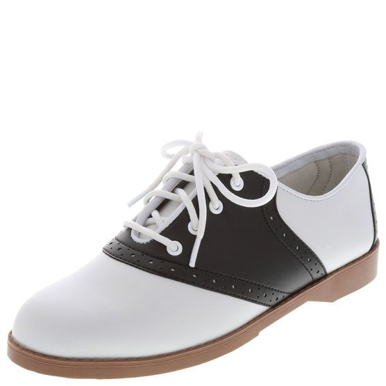 "This traditional saddle oxford is perfect for school uniforms or for those who want to convey ""school girl"" style. It features a durable upper with classic saddle oxford perforation details and laces for a great fit, padded insole for comfort, and a lightweight, flexible outsole. Manmade materials."