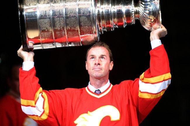 """Joe Nieuwendyk hoists the Stanley Cup after winning it in Calgary in 1989"""