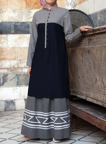 Bi-Color Tunic Save 50% Black color  This tunic is for those who appreciate the simple things in life. It features crisp and clean contrasting color blocks that makes mixing and matching easy.