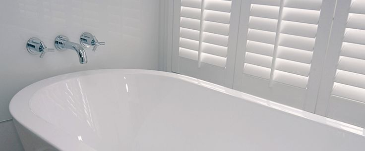 A beautiful free standing bath adds a touch of luxury to this ensuite bathroom.