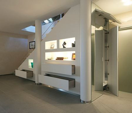 under stairs closet. The space under a staircase can be used to keep everyday clutter out of the way. http://hative.com/clever-stairs-storage-ideas/