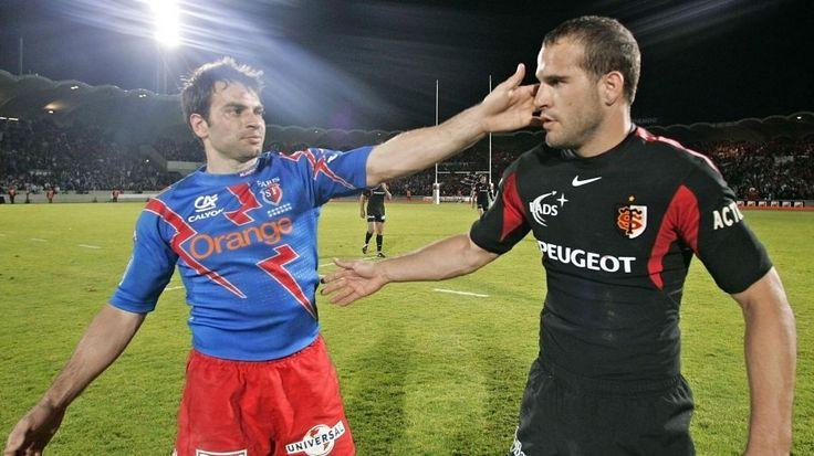 Christophe Dominici (Stade français) et Frédéric Michalak (Toulouse) - 3 juin 2005AFP