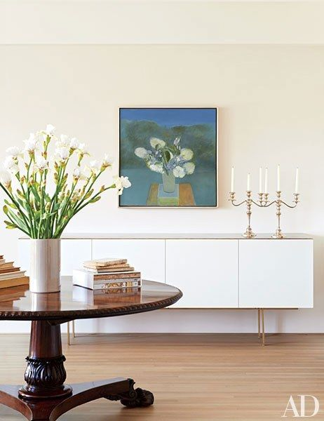 A Jane Freilicher painting is mounted in the living room; the sideboard is by David Bers.