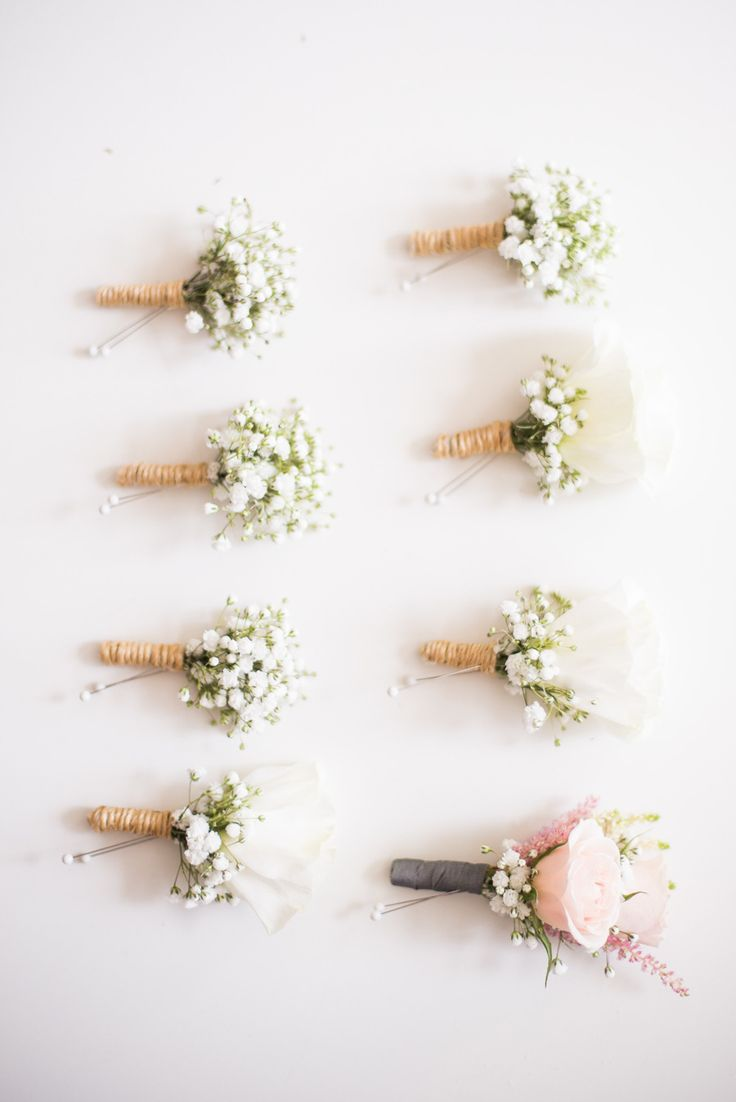 Baby's Breath Boutonnieres | See the #ShabbyChic wedding on SMP - http://www.StyleMePretty.com/canada-weddings/manitoba/winnipeg/2014/01/21/diy-vintage-wedding-in-winnipeg-manitoba-canada/  Rachwal Photography