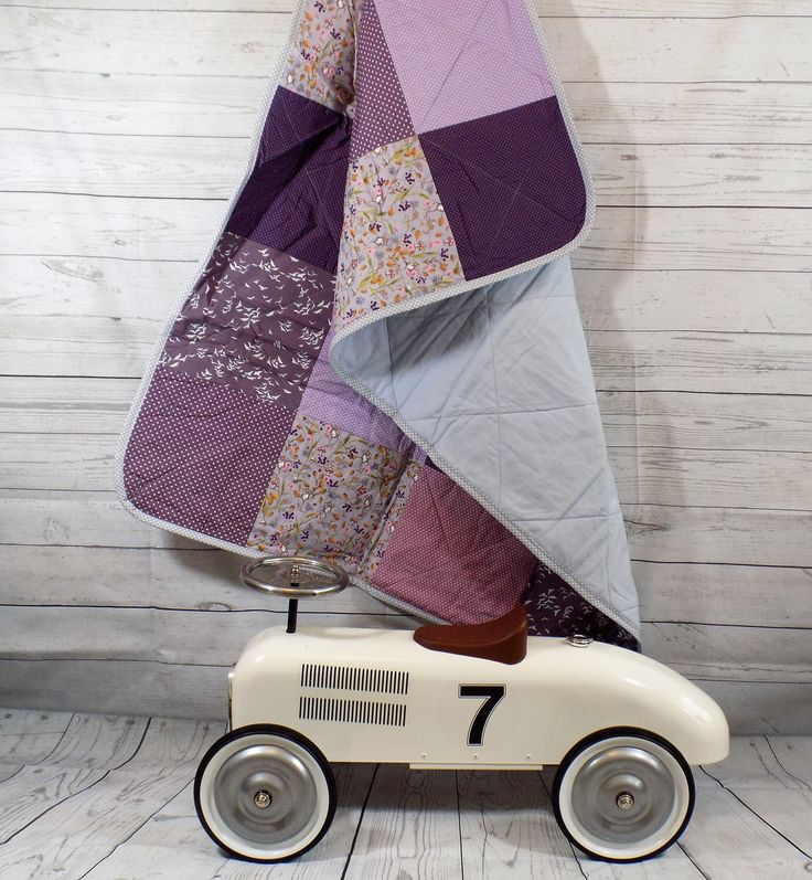 A personal favourite from my Etsy shop https://www.etsy.com/uk/listing/234503295/purple-baby-blanket-baby-quilt-modern