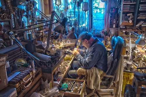 The workbench of Ryszard Krukowski, here he is working hard cutting fabulous Fire Agate. As an artist, it makes sense that his workbench is as eccentric as he is!