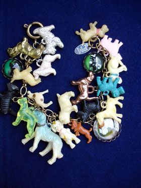 Vintage Dogs Charm Bracelet with Big Blue Dog  This one has 21 different, vintage, dog charms including celluloid, metal, glass cabochons. All the charms are vintage and special and many breeds are represented including: Scottish Terriers, Boxers, Bulldogs, Dachshunds, mutts and more! The center has a wonderful big blue dog!...