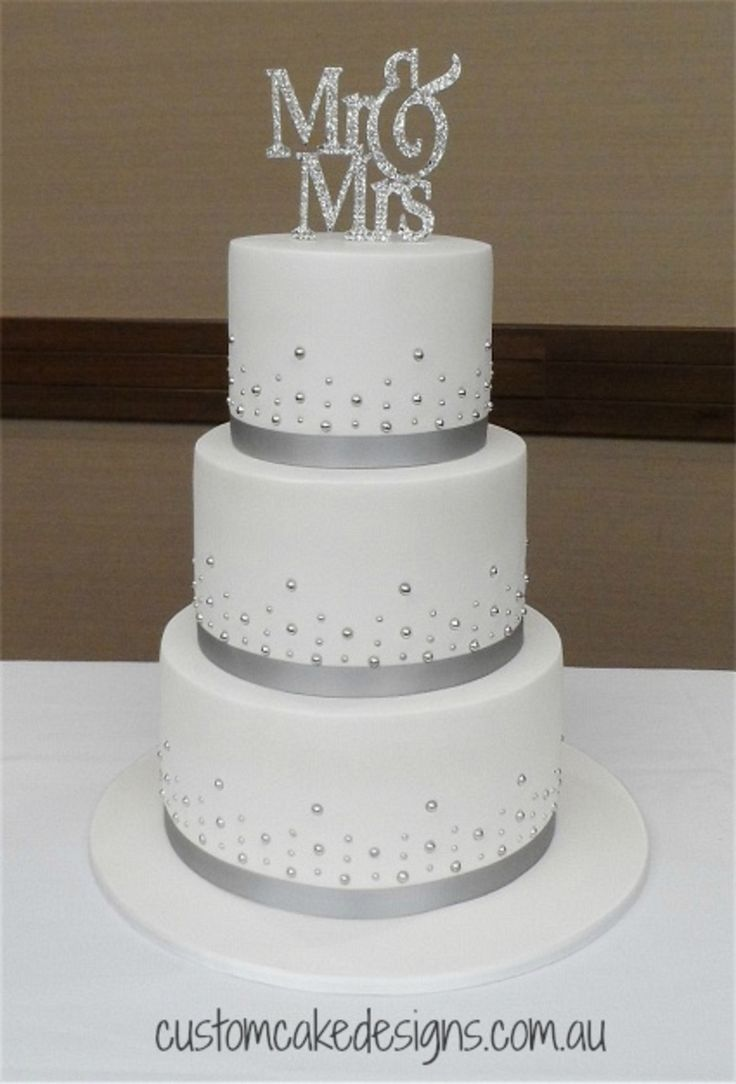 this elegant and simple design was chosen by the bride to match their silver and white wedding theme this cake was made from choc mud with a choc fudge - Wedding Cake Design Ideas