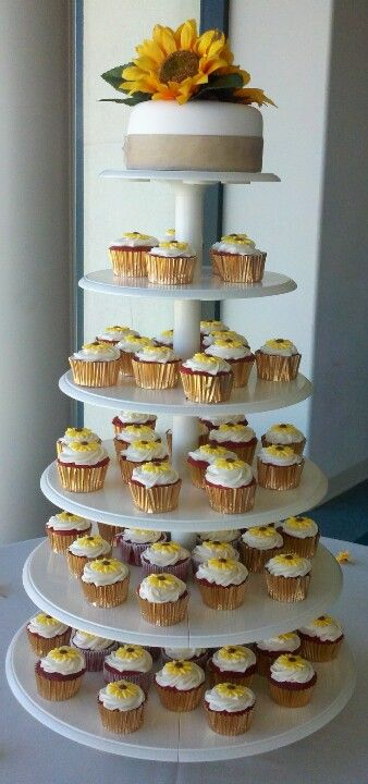 Sunflower wedding cake and cupcakes