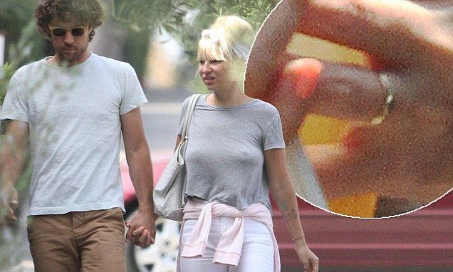 Australian singer-songwriter Sia Furler seems to have confirmed reports she wed fiancee Erik Anders Lang this month by stepping out wearing what looks to be a wedding band.