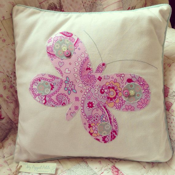 Pink paisley butterfly cushion
