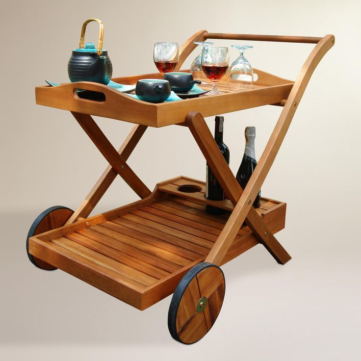 A removable top tray with handles, a bottom shelf and bottle storage make our contemporary serving cart an alfresco entertaining essential. Featuring rubber wheels for easy indoor-outdoor transport, it's constructed of solid eucalyptus wood, renowned for its resistance to weather and everyday wear and tear.