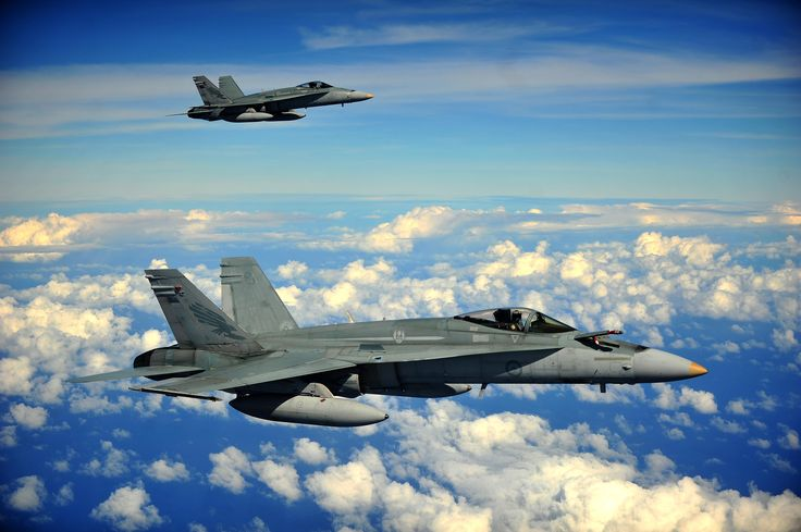 Royal Australian Air Force F/A-18 Hornets form up to conduct an air refuel while participating in Cope North 13 Feb,2013,near Anderson AFB,Guam.F/A-18 a multi-role fighter designed for both air-to-air & air-to-ground missions.Cope North annual air combat tactics,humanitarian assistance & disaster relief exercise designed to increase readiness & interoperability of U.S. Air Force, Japan Air Self-Defense Force & Royal Australian Air Force. (U.S. Air Force photo/Senior Airman Matthew Bruch)