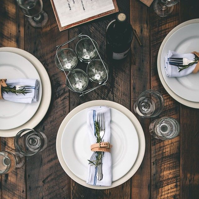clever idea ... use a 'favor' to wrap the silverware + napkin for the place setting, in this case, a leather bracelet | gatherings + event ideas