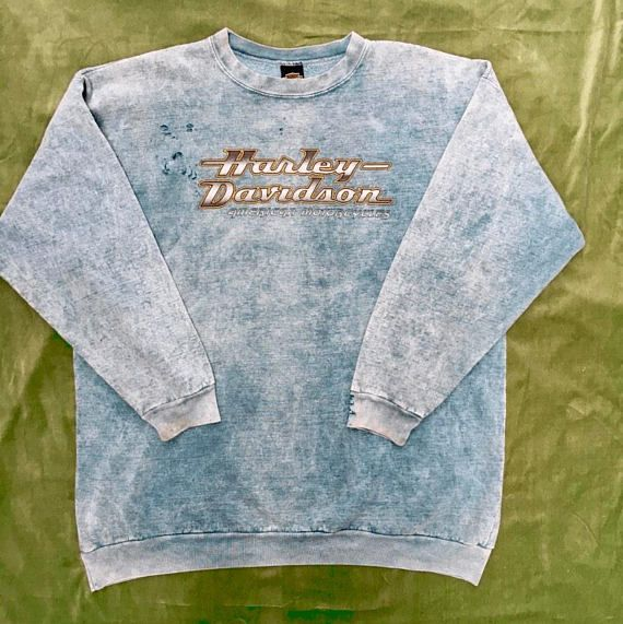Harley Davidson distressed sweatshirt. Steaming hot out of Yucca Valley (for those who don't know, that's where Joshua Tree is). Color is an acid wash sea foam green, there are some holes on the sleeves/cuffs and chest, probably from wrenching on a chopper. Size 2XL 26″ across the
