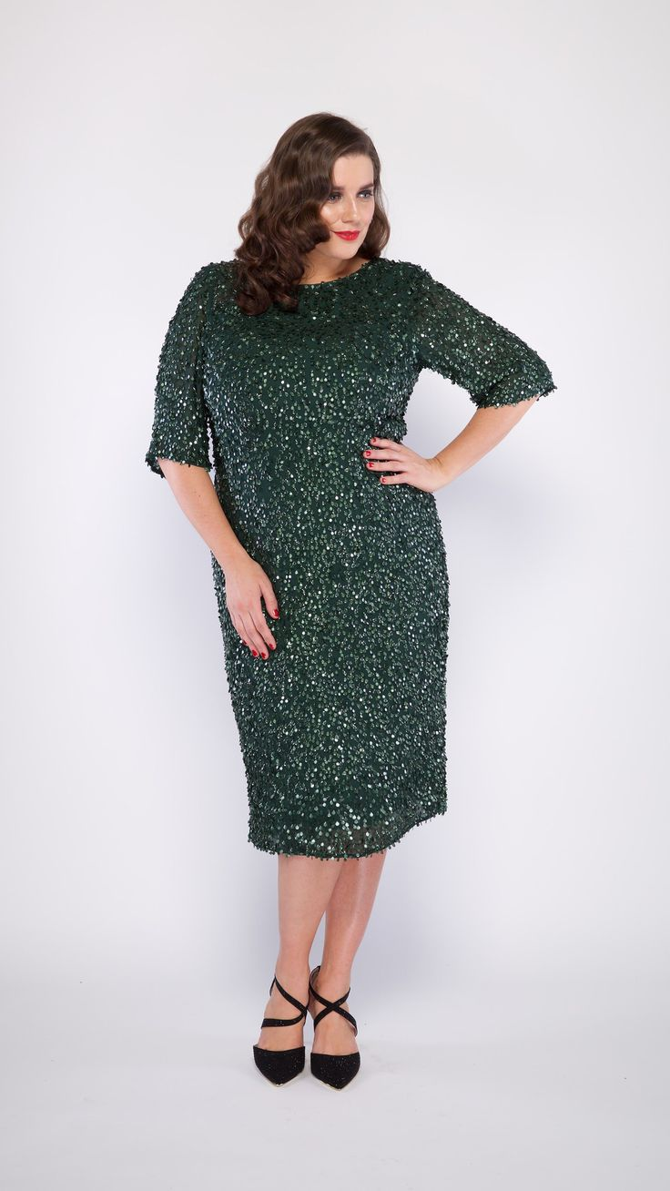 The GRACE dress in forest green. A classic all over sequinned dress in cocktail length. Available in plus size and standard size. . #viviennalorikeet#gowns#wedding #eveningwear#custommade #madetomeasure#highfashion#fashion #plussize#runwayfashion#bodypositive #glam#motherofthebride #motherofthegroom#cocktaildress#style #sequinned#beautiful#luxury #weddingdress#bridal#silk#classic #armadale#melbourne#handbeaded #couture#shop#customdress#femininity