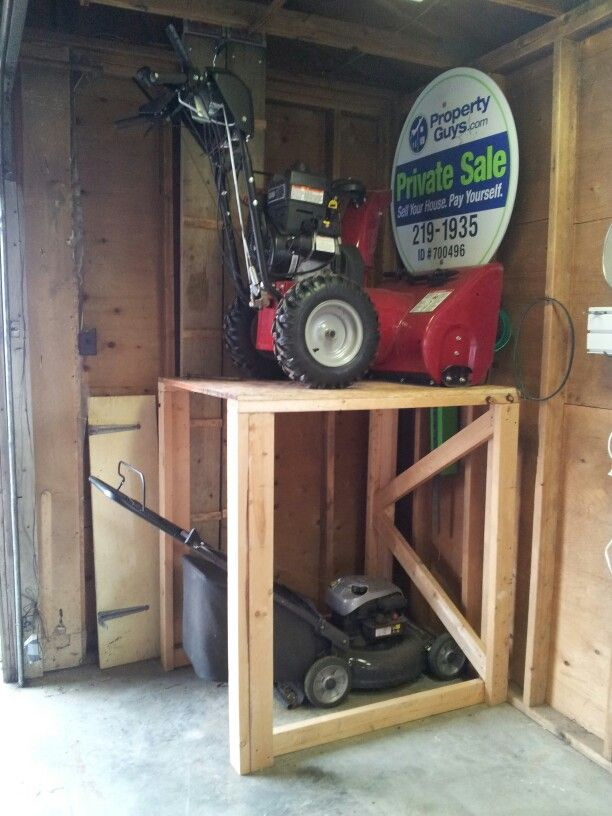 My Invention: Depending on the season, stack your snow blower or lawn mower above the other to save space.