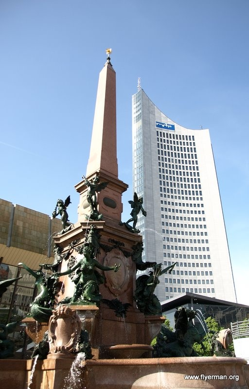 The City High-rise and the Mende Fountain in Leipzig at the Augustusplatz square.