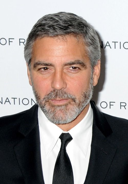 """George Clooney stated, """"I'm not going to let anyone make it seem like being gay is a bad thing. My private life is private, and I'm very happy in it. Who does it hurt if someone thinks I'm gay?"""""""