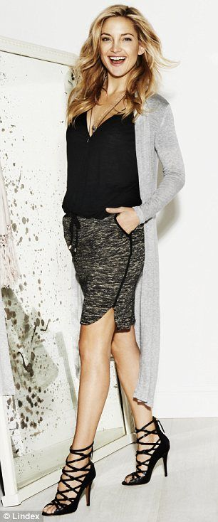 So chic: The 34-year-old sports a couple of smart pencil skirts in the campaign, which are perfect for the office