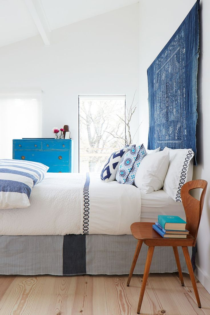 Don't ignore the space above your bed, it's the perfect place to complete your bedroom design!