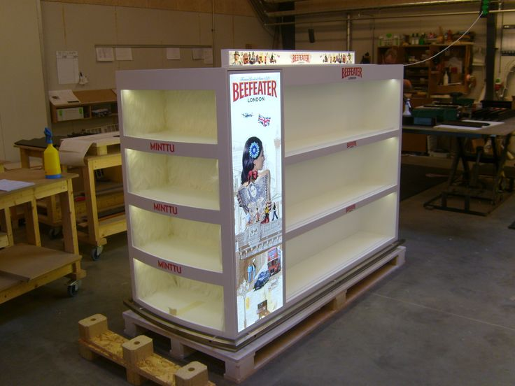 Floor unit for tax-free bordershop. The unit is designed with special lightning, isbear fur, metalic effects and custom graphics in order to set the scene of the three brands it holds.