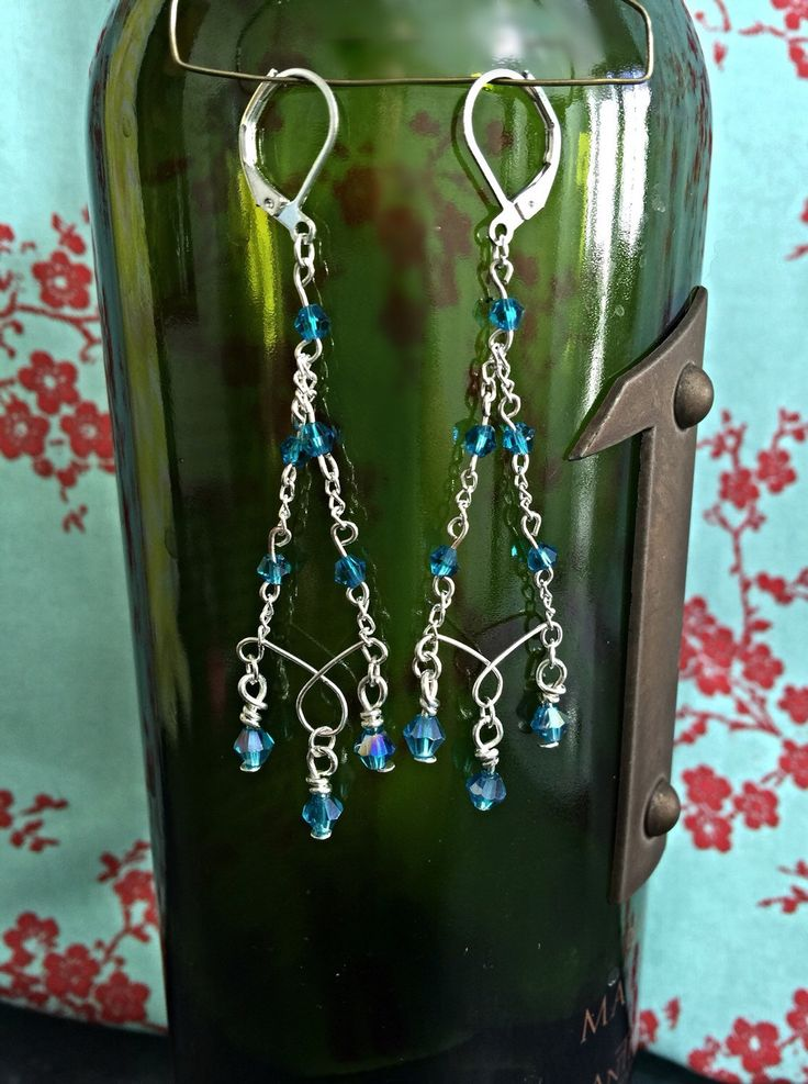 A personal favorite from my Etsy shop https://www.etsy.com/listing/232190269/silver-teal-chandelier-earrings